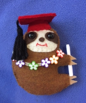 Grad sloth red cap and lei