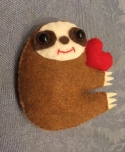 Auburn sloth with heart