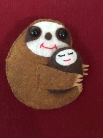 Mom sloth on red